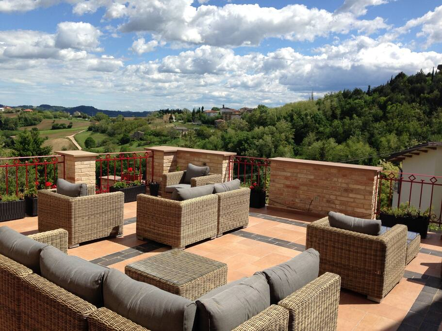 Enjoy prosecco and olives on the panoramic terrace