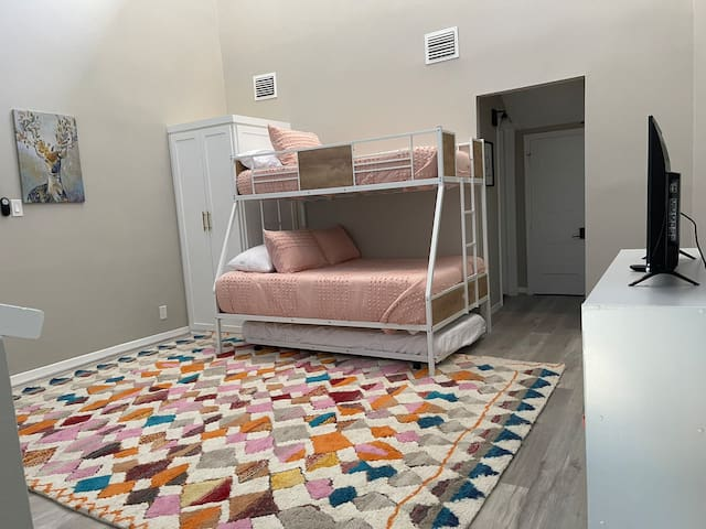 The upstairs loft bedroom is open to downstairs. A great room for kids or teens. Double/twin bunk with a trundle bed. Easily sleeps four kids.