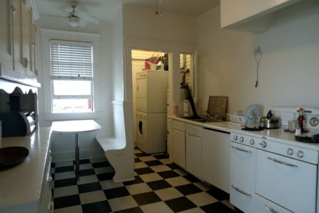 part of kitchen with breakfast nook and laundry room