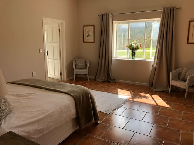 The second bedroom has a queen-size bed with both an electric and thick furry blanket for cold nights. It has an ensuite study with fitted desk as well as an ensuite bathroom with large shower. There is a wardrobe and side tables with lamps.
