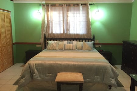 The Snuggle at 48 Baymen Ave. - Belize City