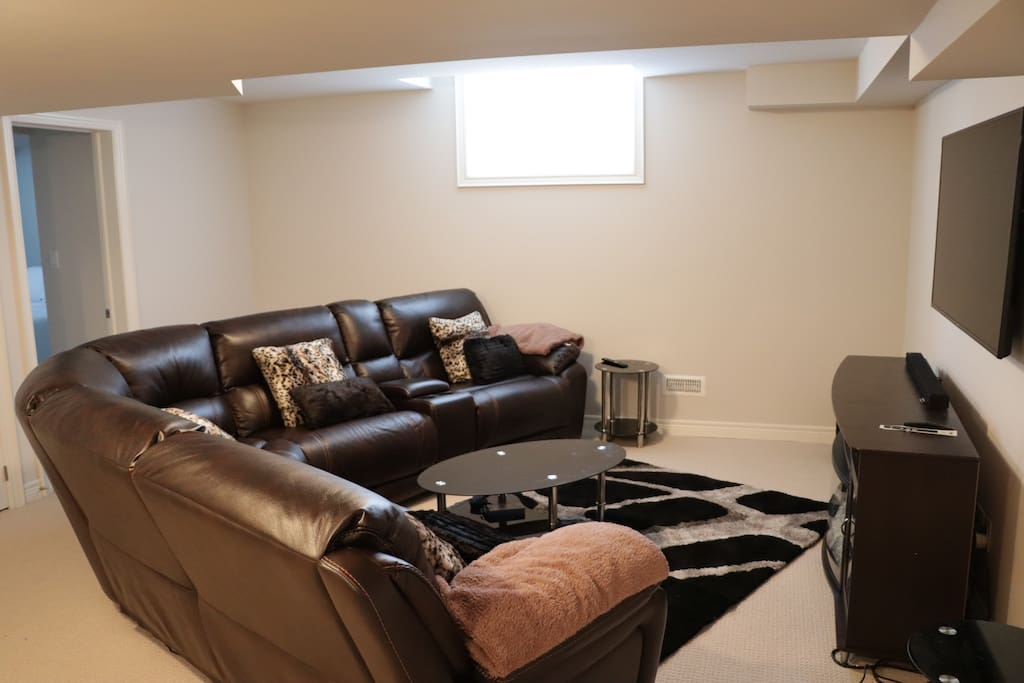 Entertainment room with a theatre style setup: (Basement)