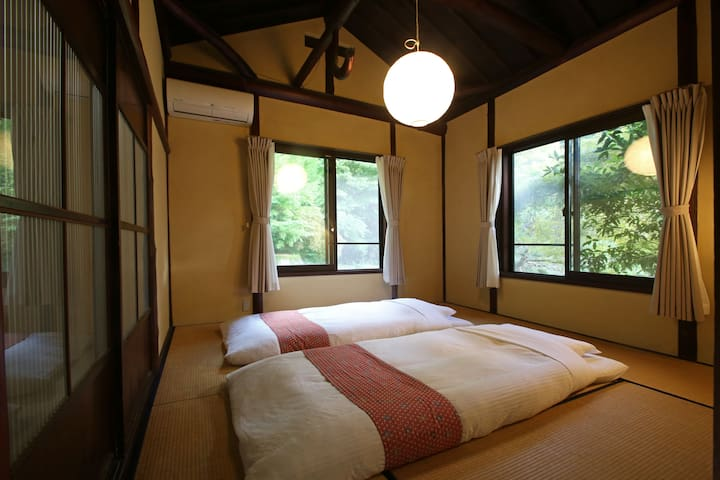 Bedroom 1 with thick futon beds up to 3 people. 和室ベッドルーム1(最大3名)