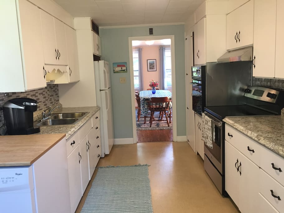 Kitchen has 2 ovens, microwave, toaster, Keurig, 12 cup coffee maker, dishwasher, blender, and all the pots, pans, dishes and utensils you need.
