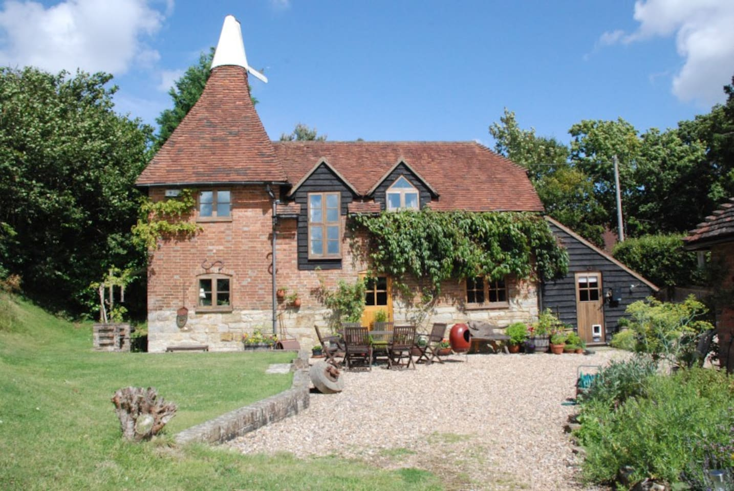 Our home is a traditional Sussex oast house, circa 1750.