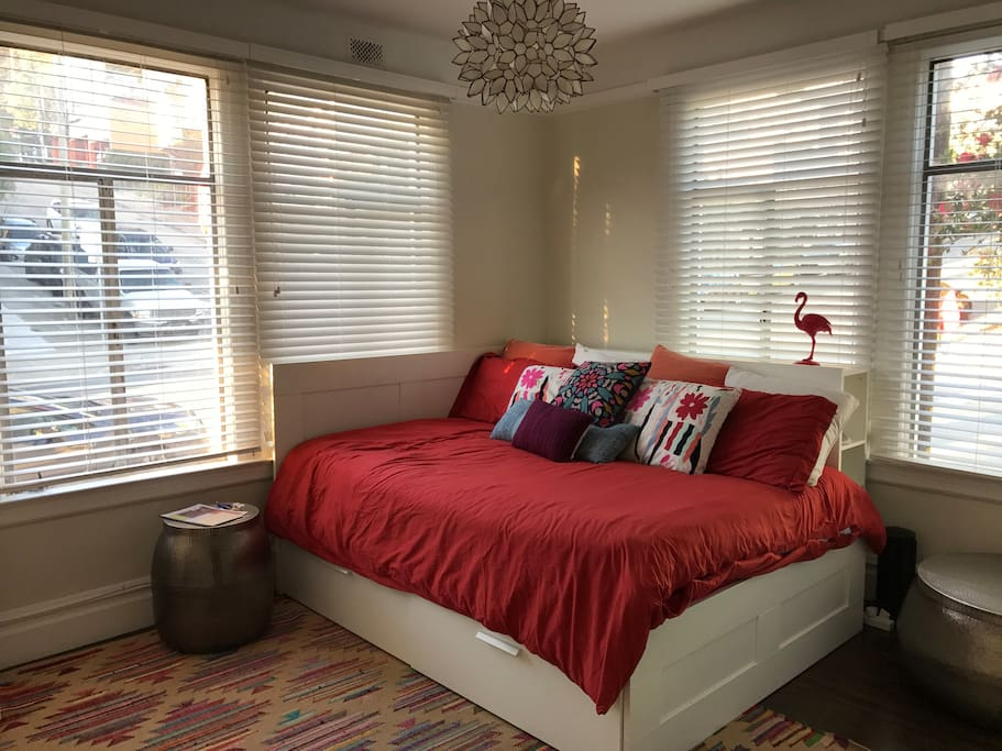 Enjoy a comfortable queen sized bed in a room with plenty of storage space.