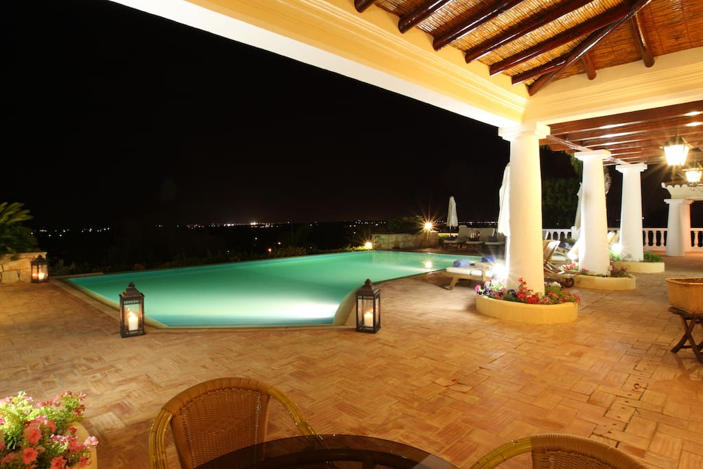 Living room covered terrace at night