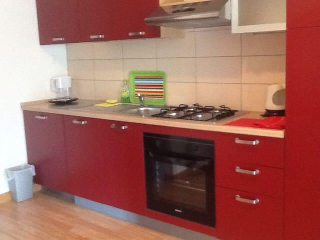Open style kitchen, dishwasher, 4 burners stove & oven, refrigerator.