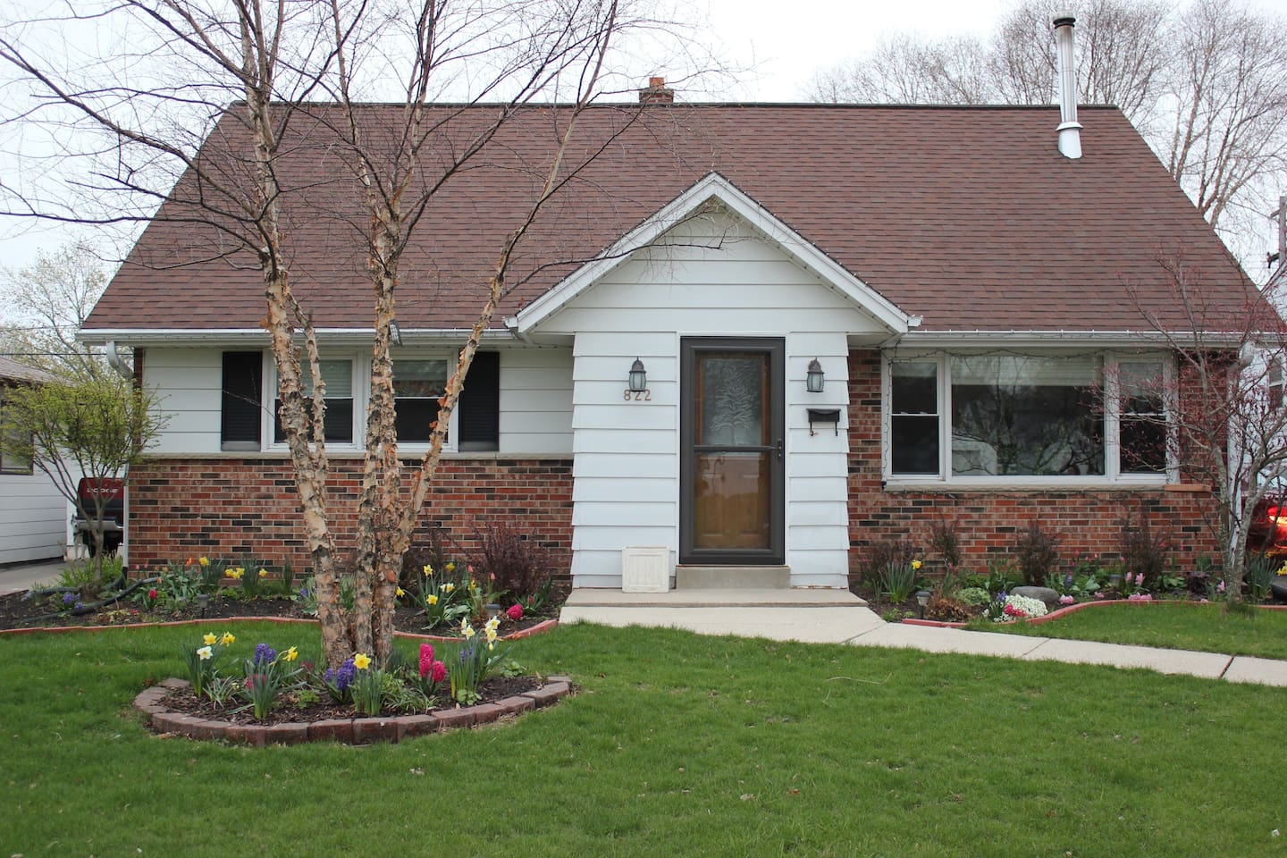 Front of home. All the spring flowers coming up! Summer is on it's way!