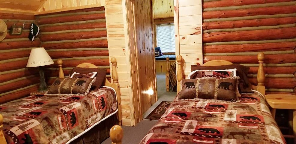 Second bedroom with 2 twin beds.  This room was added when they moved a historical cabin over to the cabin