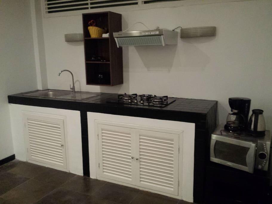 Kitchen with full kitchen ware