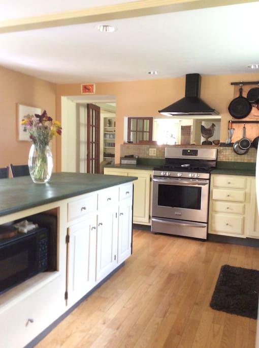 Beautiful sunny kitchen with island