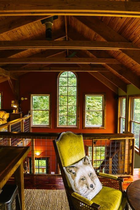 The cabin is surrounded by picture windows.