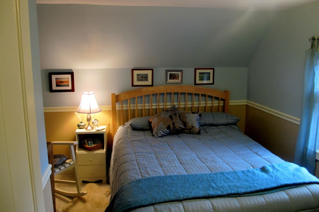 Queen-sized bed, underbed storage, west bedroom