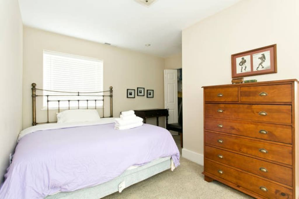Bright airy bedroom with Olympic queen sized bed.