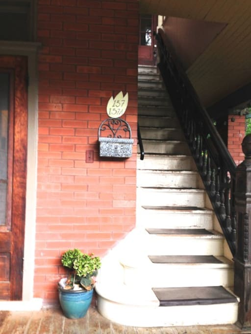 Our house's porch and the staircase that leads to airbnb apt.