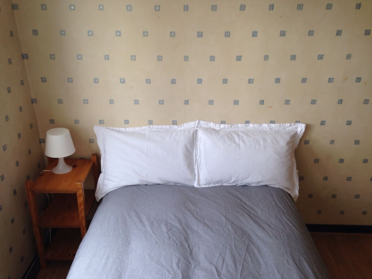 A double bed with fresh linen and anti-allergy pillows.