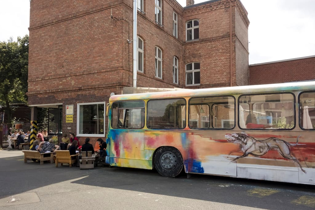 Have your coffee in a bus - just around the corner :)