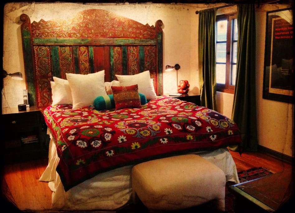 King-sized bed with yummy linens, down pillows, a headboard from India,  and a flatscreen tv with Apple tv/Netflix.