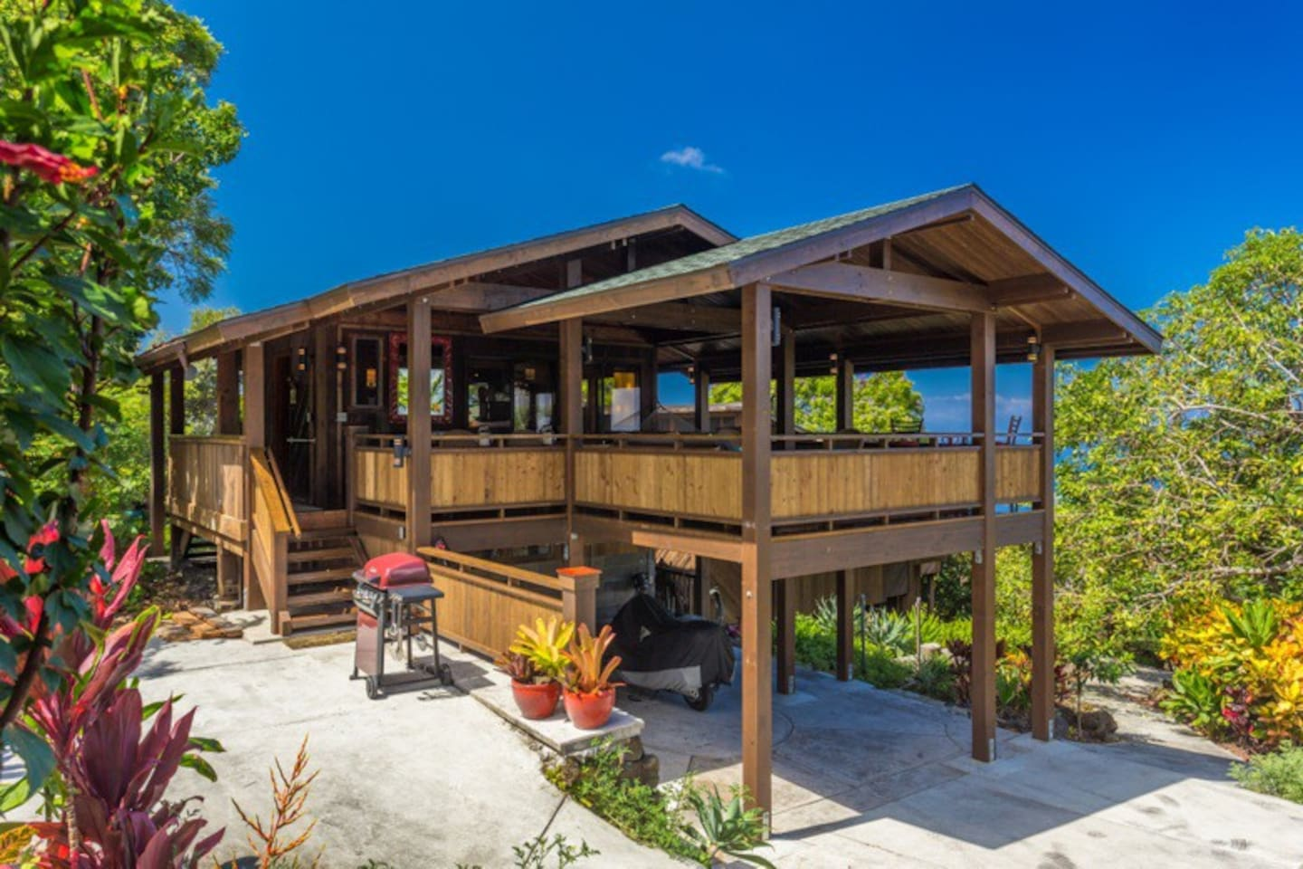 The cottage, with lanai in front and convenient barbecue area adjacent.