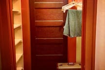 Closet with room for hanging clothing, and shelves for personal items