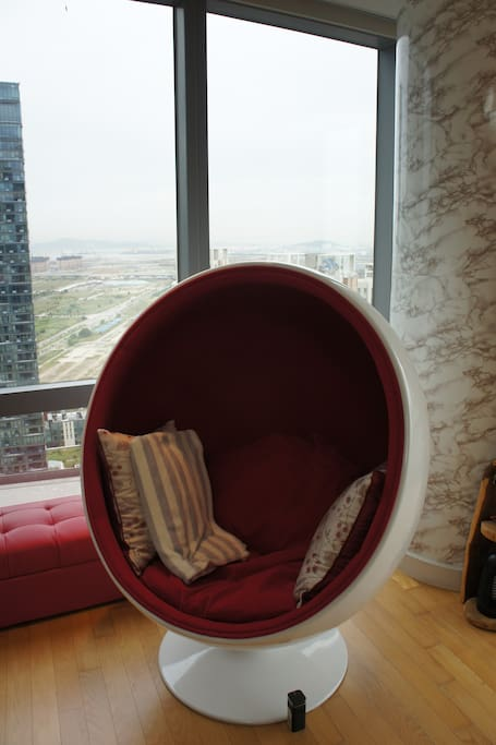 A close-up of the red egg chair.