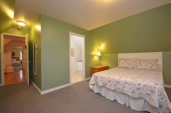 303 - Queen bed, 56 Main St.,  Wolfville, N. S.
