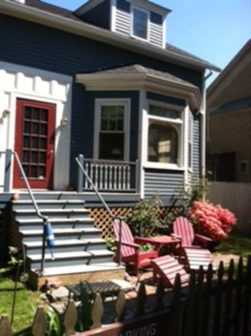 Adirondack chairs on brick patio, front yard.