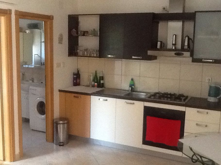 Large kitchen with full amenities.
