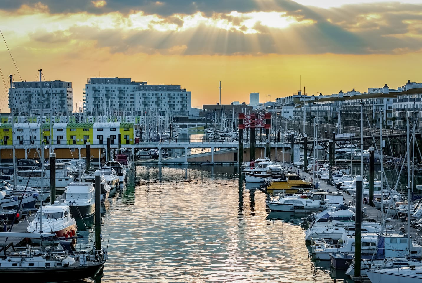 Brighton Marina at sunset, with the Rethink Living apartments in the background (large buildings, top left of the picture)