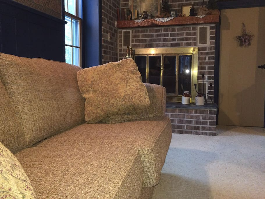 Sitting area in the downstairs of the guest house, your private retreat. Sofa opens to queen size bed.