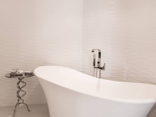 free standing bath in master bedroom