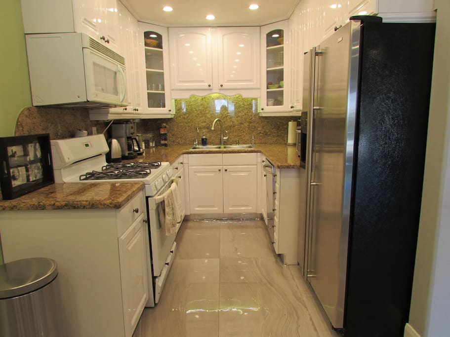 Full Kitchen with all updated amenities including stove, oven, microwave, toaster oven, dishwasher, fridge, electric kettle and coffee machine.
