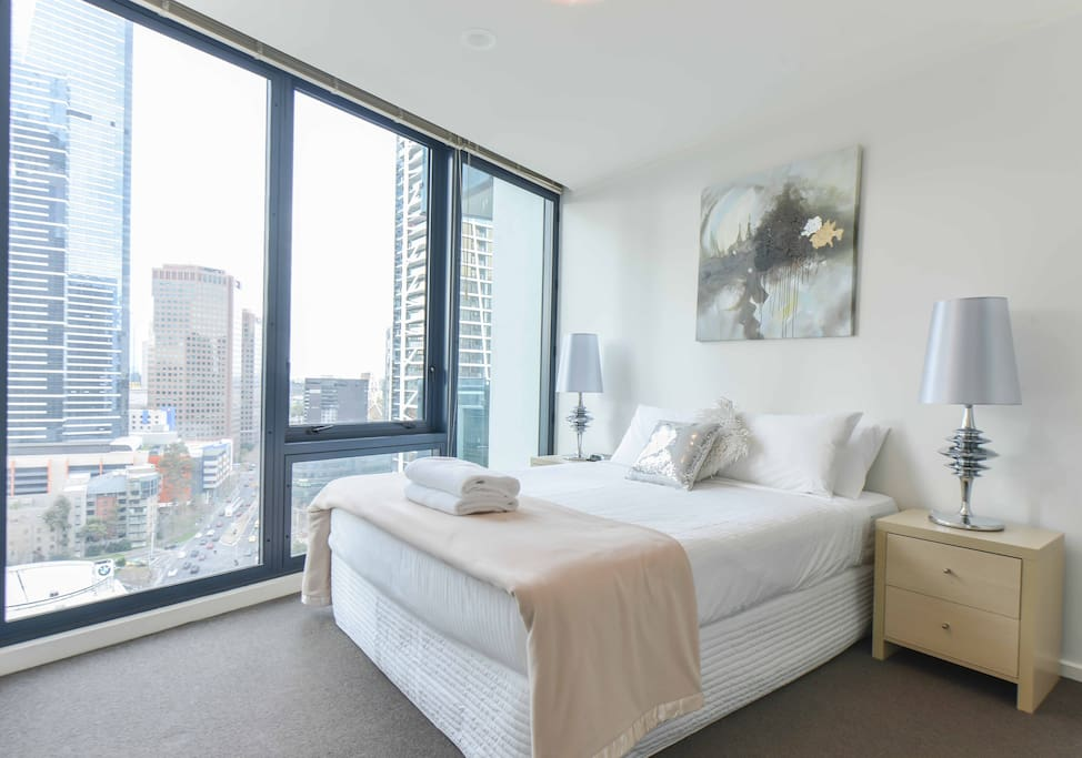 Comfortable queen bedroom with city views in this 3 bedroom StayCentral Southbank serviced apartment