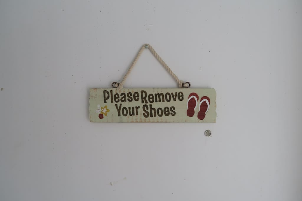 Please remove you shoes, flip flops, sandals, etc. before entering.  It's a Hawaii thing :)