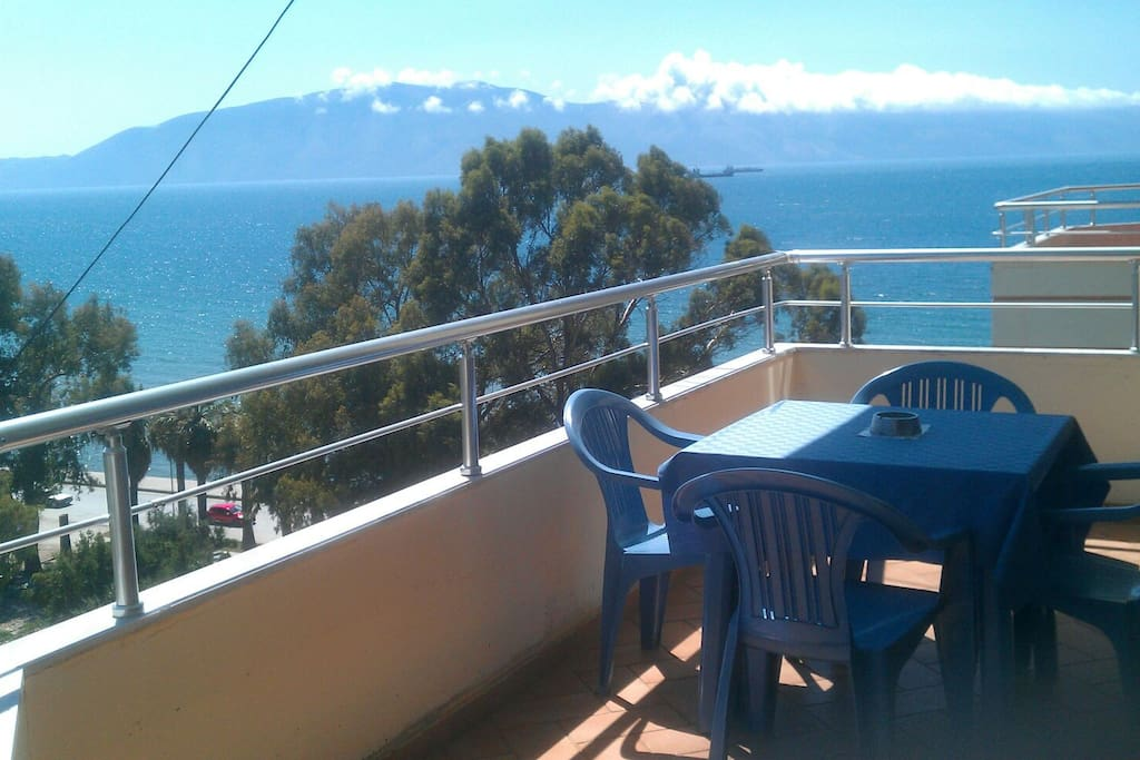 Large balcony with an amazing view of sea and mountain.