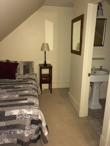 Comfortable bedroom with a full size bed.