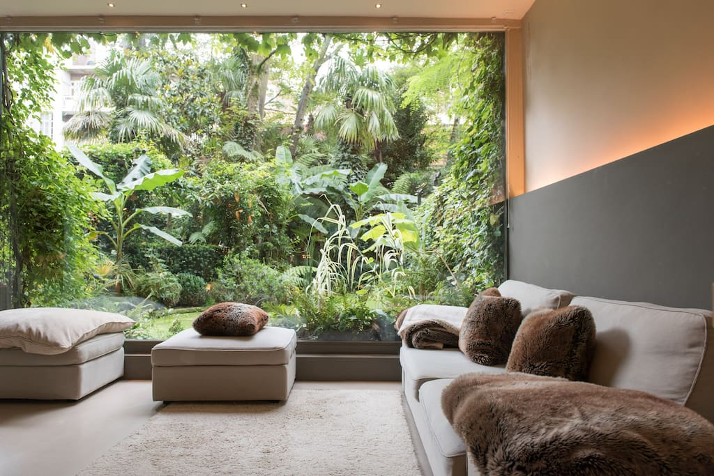 Living room with the XXL window to the tropical garden