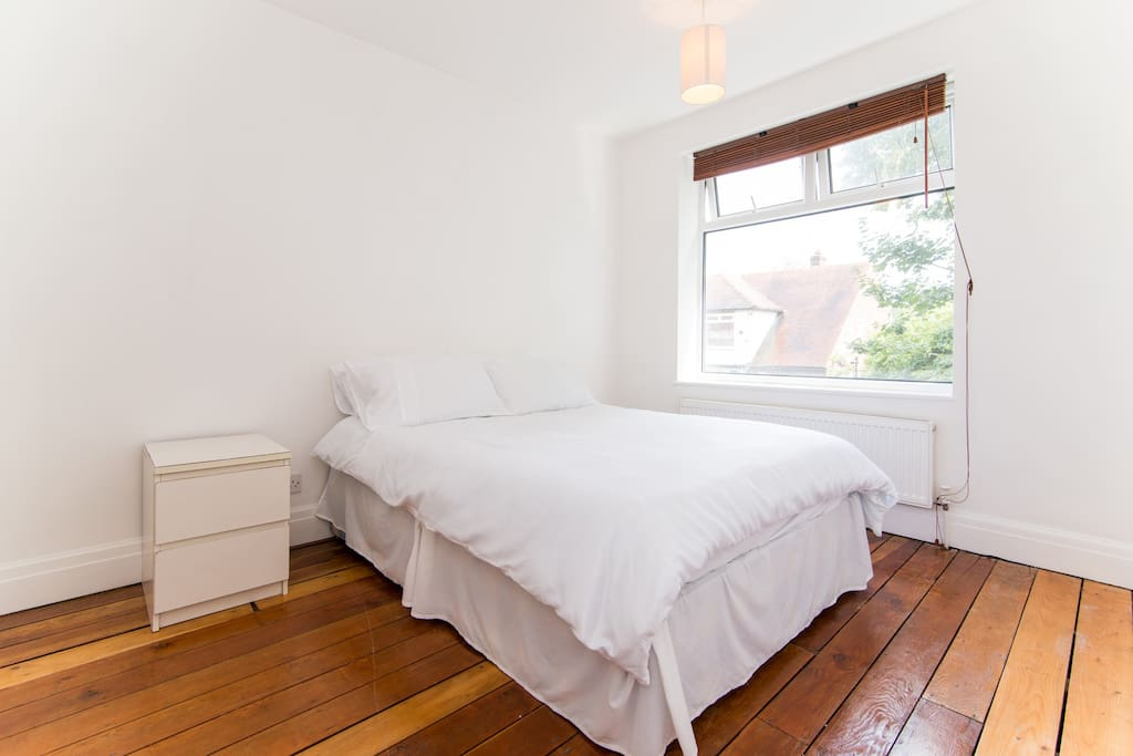 Spacious double bedroom with two single beds
