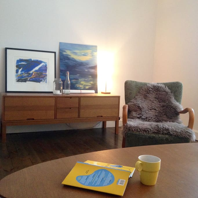My pictures have yet to go on the walls - for now they are bloggishly scattered along the floor and on the sideboard.