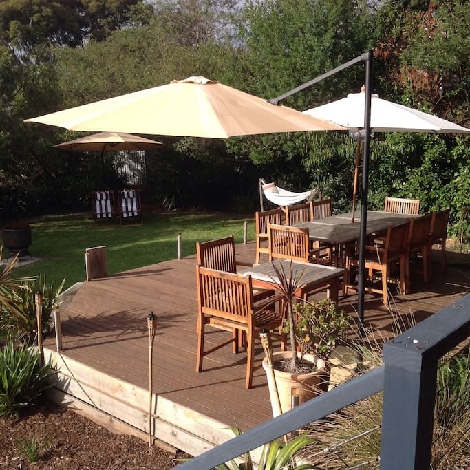 Large outdoor deck with seating for 10 people