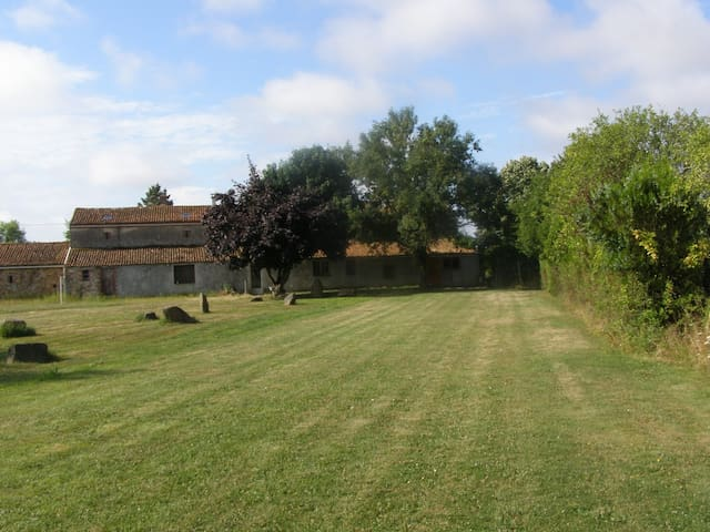 The back lawn of the gite and farmhouse for relaxing, al fresco dining,  BBQs, access to the alpacas,  games for the kids.