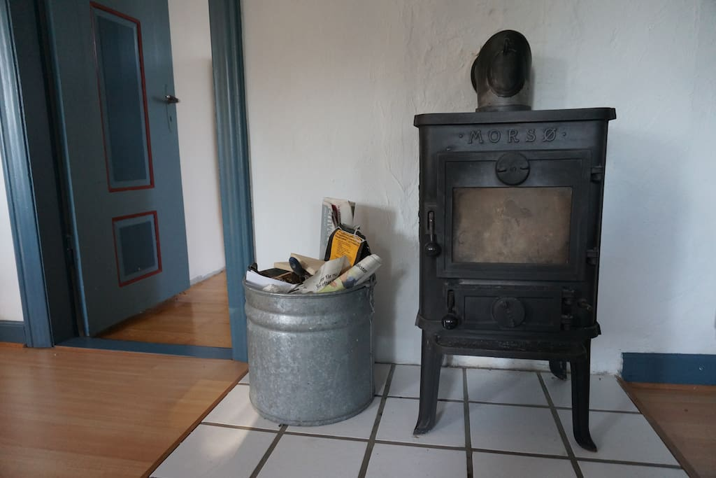What's hygge without a fireplace? The house comes complete with firewood for your first fire - and outside there's of course also a BBQ