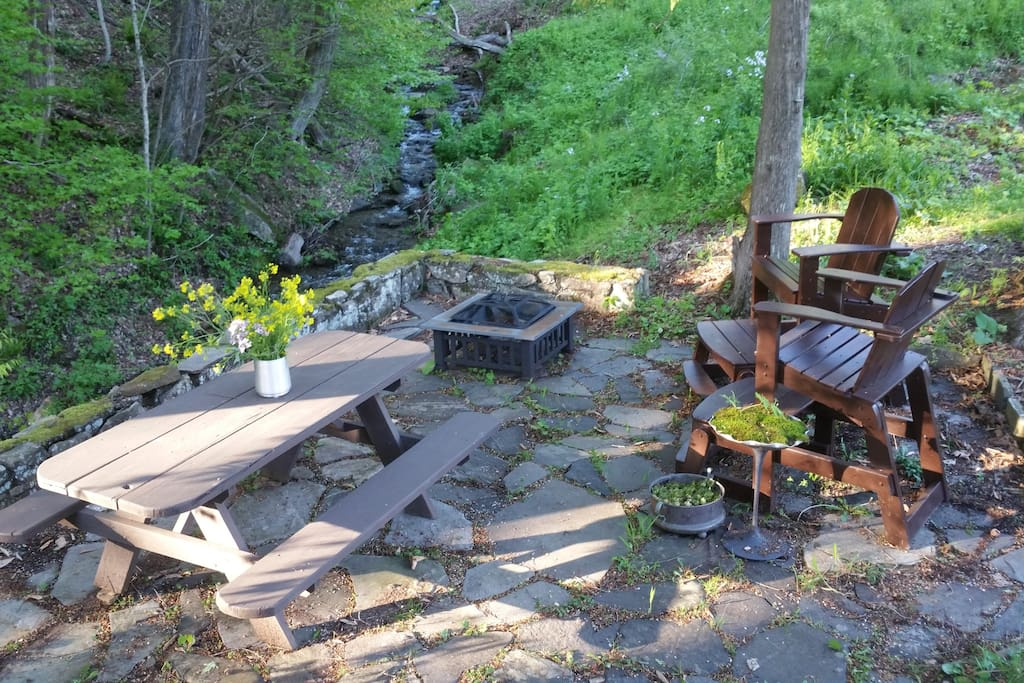 private stone patio, with creek view