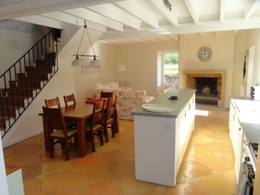 Kitchen, dining area, with sitting room in the background