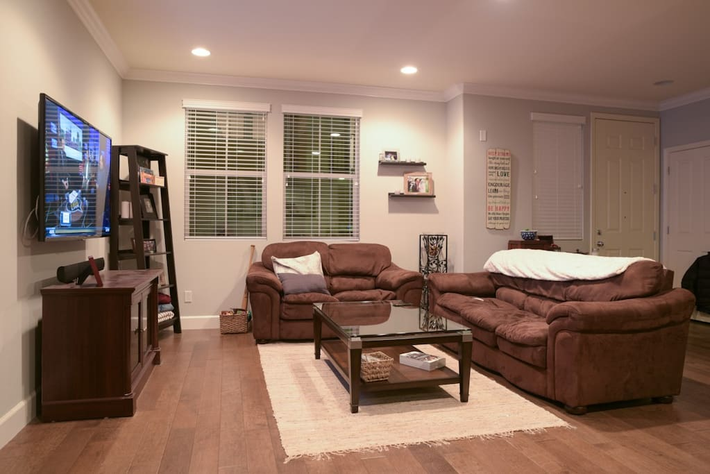 Spacious living space with 60 inch tv and plenty of seating