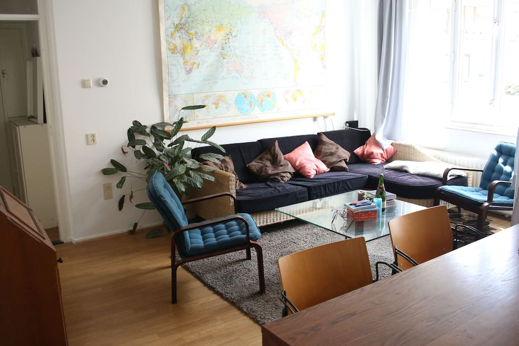 The (shared) living-room, with a big sofa for relaxing.