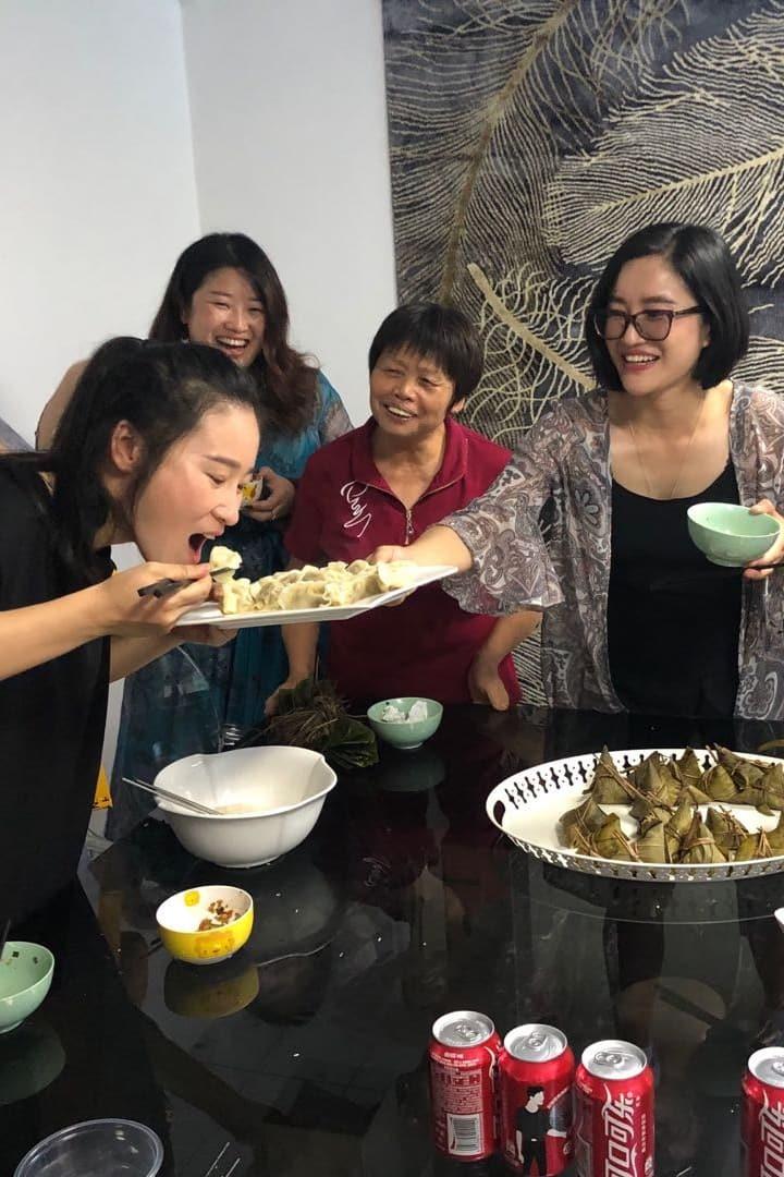 Enjoying dumpling meal in dining hall