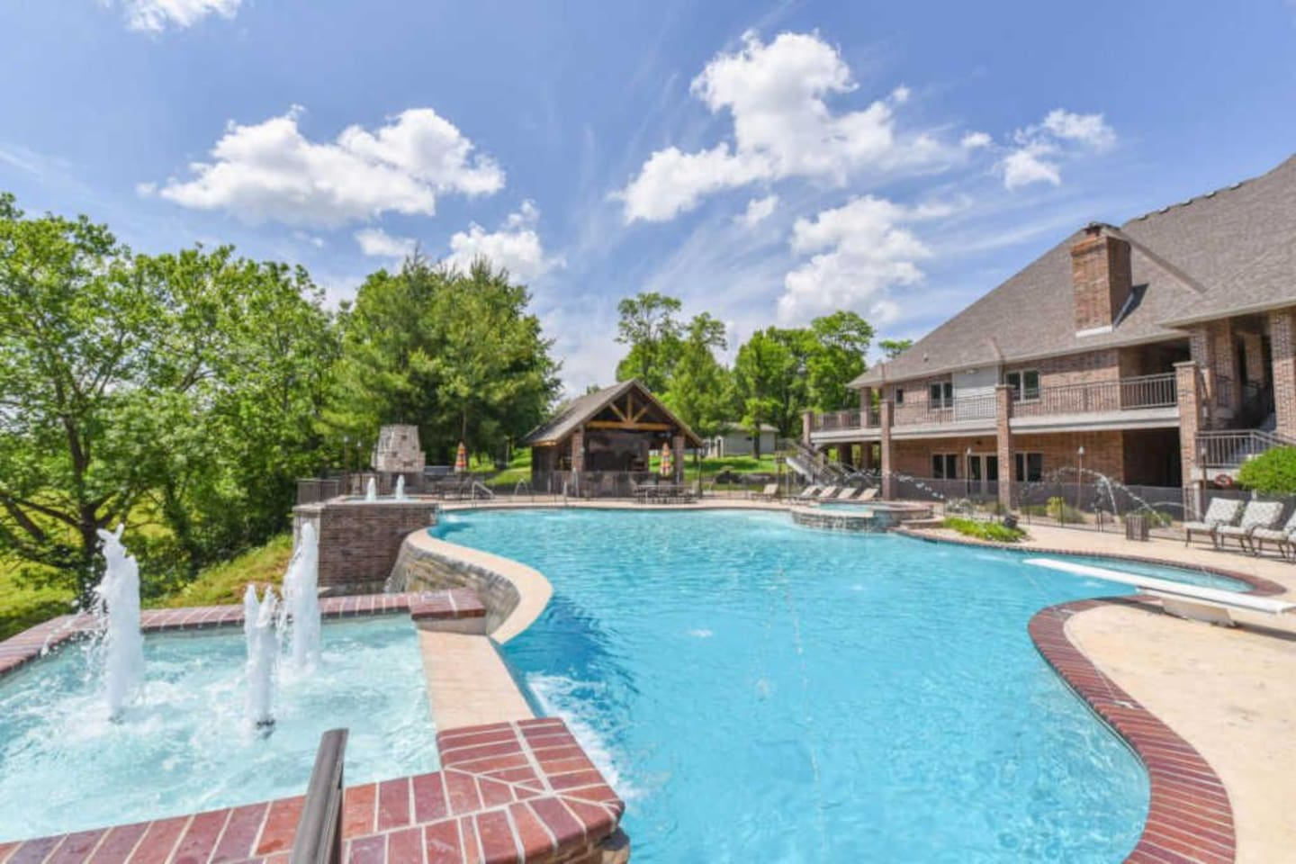 Unbelievable pool deck area.  Over 10,000 square feet!  Tiki bar/cabana, upper and lower deck, huge pool with beautiful fountains and diving board.