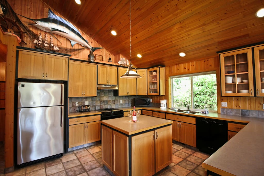 Upper level fully equipped kitchen with prep island, plenty of counter space and a breakfast bar for 3